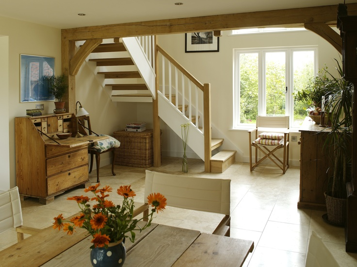 Border Oak - Light and airy hallway in a contemporary barn.