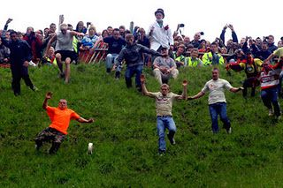 Weird Sports: Cheese Rolling  Each year people from all over the world gather at The Cooper's Hill near Gloucester with their Double Gloucester Cheese, to take part in the annual event known to the world as the Cooper's Hill Cheese Rolling Competition.   The objective of the game is to roll your cheese and chasing it anyway you can. The cheese can reach of speeds upto 70 mph with the participants at much the same speed. Due to the steepness and unevenness of the hill and the high speeds…