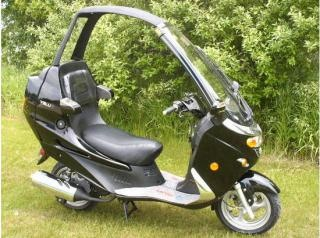 Diamo Velux- Probably the worst built scooter ever. It's like driving a two wheel corvair. BUT- it does have a convertible top, a cd stereo, and a large trunk. It's my project scooter and I'm pimping it out.