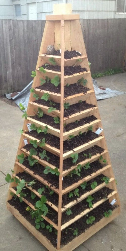 Vertical Pyramid Flower Bed - 40 Beautiful and Easy DIY Flower Beds to Brighten Your Outdoors