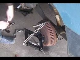 Brake Drum Puller - Homemade brake drum puller constructed from a scissors jack, puller, and chain.
