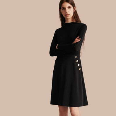 A flattering A-line Burberry silhouette with gentle gathers through the military-inspired skirt. The long-sleeved top is knitted in a stretch silk wool blend, adding texture and comfort. Pair with brogues for the office.