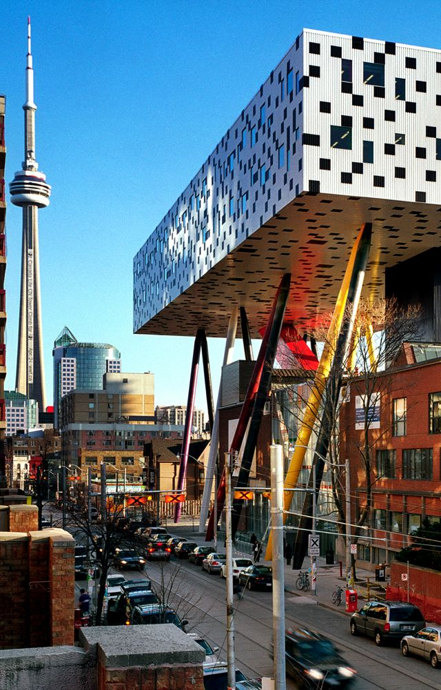 .~Ontario College of Art and Design. Designed by Allsop. An addition Supported by pillars that look like pencil crayons over the original building. Toronto - Fantastic~.