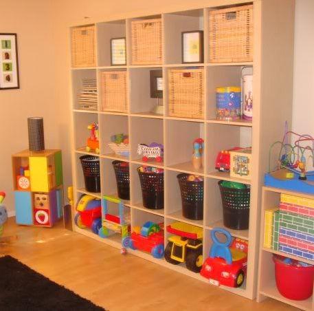 Toy Storage...I have shelves in the basement I wonder if I got some baskets I could get our basement organized...hmmm