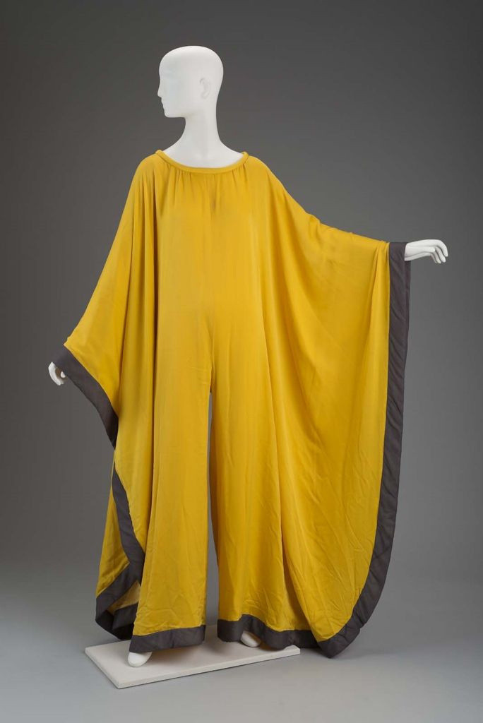 Woman's evening jumpsuit | Gnyuki Torimaru, Japanese, worked in England, born in 1937 | England, Autumn-Winter 1972 | Material: silk satin chiffon | Circular evening 'dress' is actually a jumper with culotte style pants. Yellow, trimmed with gray. Padded gray hem styled after padded hems of Japanese wedding kimono | Museum of Fine Arts, Boston