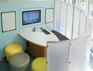 Study pod in Edinburgh University library, designed to encourage group work. The screen can be unbolted to open up the area.