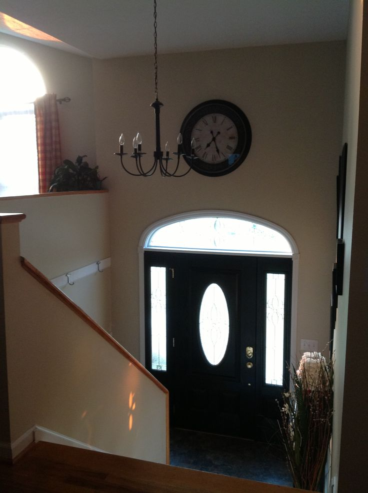 Clock hung over door in split entry foyer for the home for Split wall