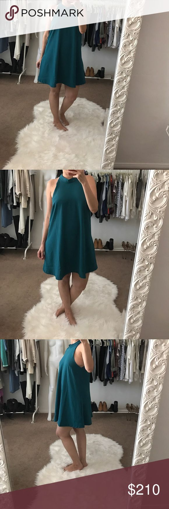 Lovers + Friends Teal A-Line Pocket Dress Lovers + Friends Teal A-Line Pocket Dress.  What's not to love about pockets on dresses? Love this gorgeous teal color.  Lined, keyhole detail back with button, super chic, makes a great cocktail dress. Lovers + Friends Dresses