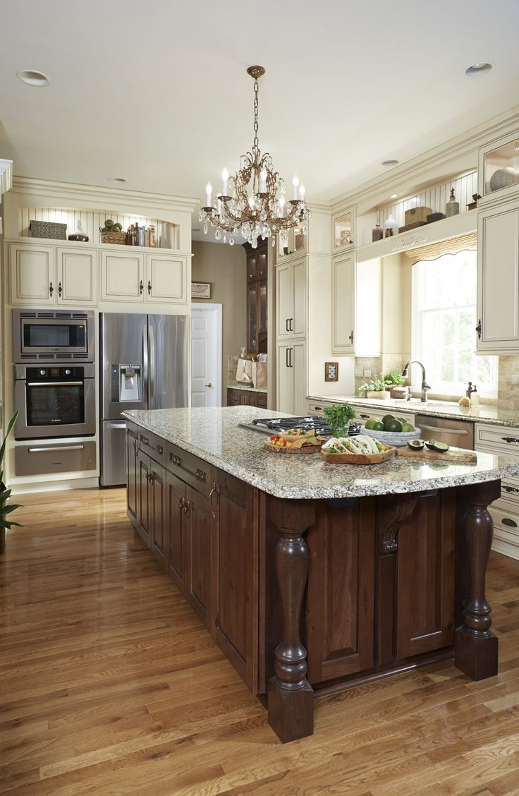 add an island with different color cabinets to create a dynamic look in your kitchen
