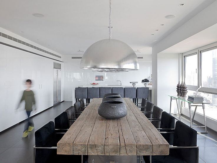 white kitchen, wall of cabinets, long rustic table, huge silver pendants