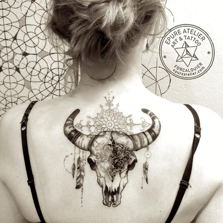 Cow skull tattoo by Marie Roura -- I love this size and placement. I'd probably go a little bigger.
