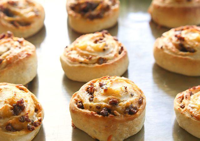 golden brown rolls on baking sheet