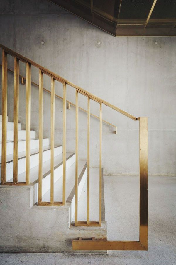 Brass and concrete staircase. barefootstyling.com