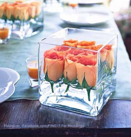 Minimalistic, trying to cut back on the floral budget? Try these orange rose centerpieces perfectly placed next to eachother sitting in the perfect amount of water great for spring weddings and small weddings