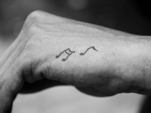 music note cat tattoo 26 Charming Music Tattoos For Guys