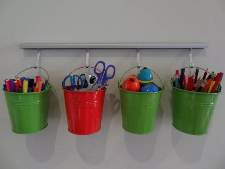 Buckets are a good choice for organizing art supplies.