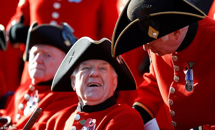 Chelsea Pensioners talk among themselves ahead of services at the Cenotaph for Remembrance Sunday