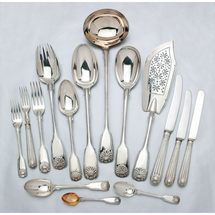 A VICTORIAN SILVER FIDDLE, THREAD AND SHELL PATTERN SILVER FLATWARE SERVICE, MAJORITY GEORGE ADAMS, LONDON 1840-1850'S comprising; twelve dinner forks, entree forks, soup spoons, dessert spoons, teaspoons, dinner knives, six each fruit forks, fruit knives, egg spoons, two basting spoons, a large ladle, sugar tongs, sifting spoon, fish slice and carving fork, various dates together with a William IV serving spoon and fork and six Edwardian entree knives