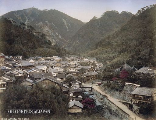 1890's. View on Arima Onsen. Houses, onsen ryokan (spa inns) and white kura (traditional storehouse) are crammed together at Arima Onsen, the ancient hot water spa nearby Kobe. The Arimagawa winds itself along the edge of the village. The white bridge crossing the Arimagawa is Taikobashi (太古橋). It connects the village with the Sanda Kaido (三田街道), the highway that lead to nearby Sanda.