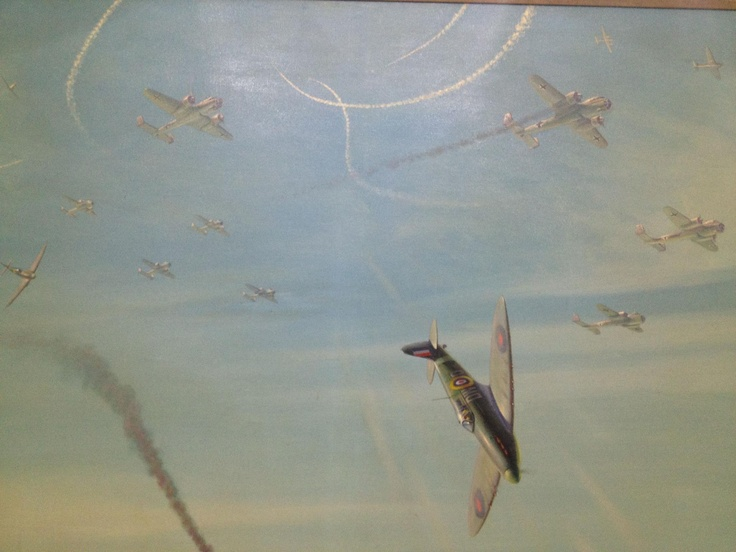 An amazing painting of a Spitfire dogfight on the walls of The Club.