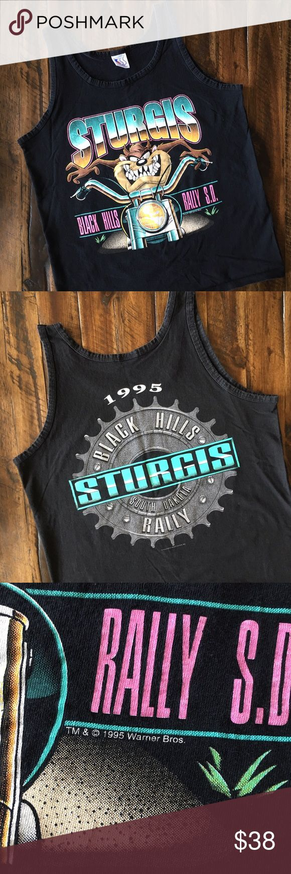'95 / Taz Moto Tank Vintage Sturgis Black Hills Rally tank with neon graphics.  BRAND:  MATERIAL:  YEAR/ERA: 1995 LABEL SIZE:  BEST FIT: S  MEASUREMENTS: Chest inches Length inches   🚫 I do not model or trade, sorry! 💟 Check out my closet for more vintage tees!     0083 Vintage Tops Tank Tops