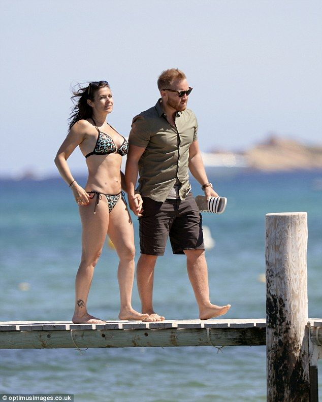 Holding hands: They remained close as they walked along a jetty together
