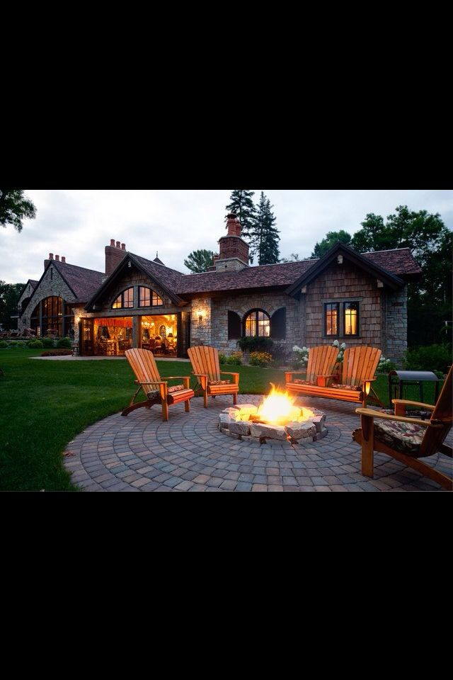Fire pit, patio idea.  Don't like the bricks in a rounded placement, but I like the idea.
