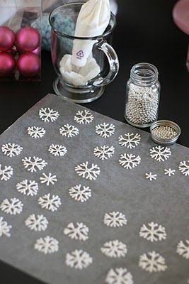 DIY snowflakes to put on top of peppermint cupcakes!