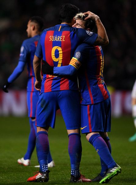 Luis Suarez of Barcelona (L) and Lionel Messi of Barcelona (R) celebrate after the final whistle during the UEFA Champions League Group C match between Celtic FC and FC Barcelona at Celtic Park Stadium on November 23, 2016 in Glasgow, Scotland.