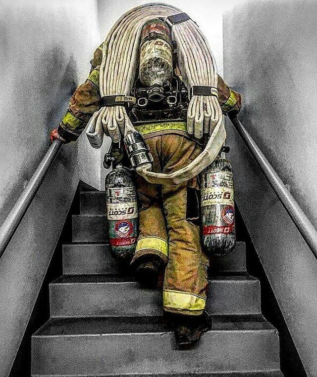 A high-rise pack and two extra SCBA bottles. First you haul these up the stairs, and THEN you go to work.