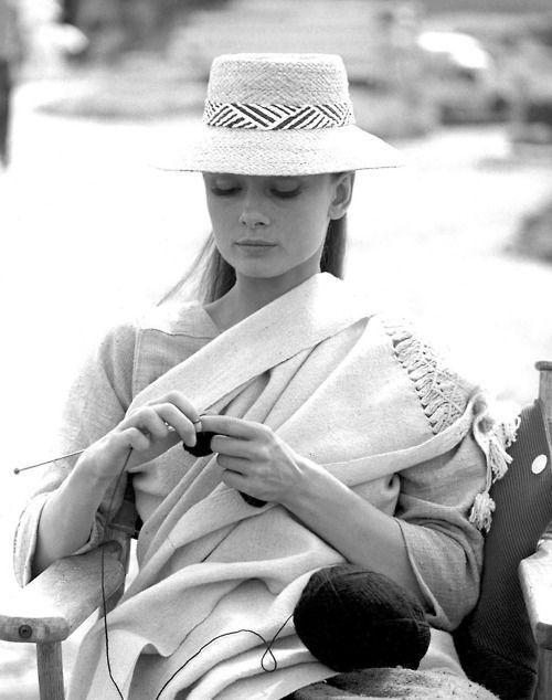 Durango, Mexico, 1959: Audrey knits between takes on the set of John Huston's The Unforgiven.