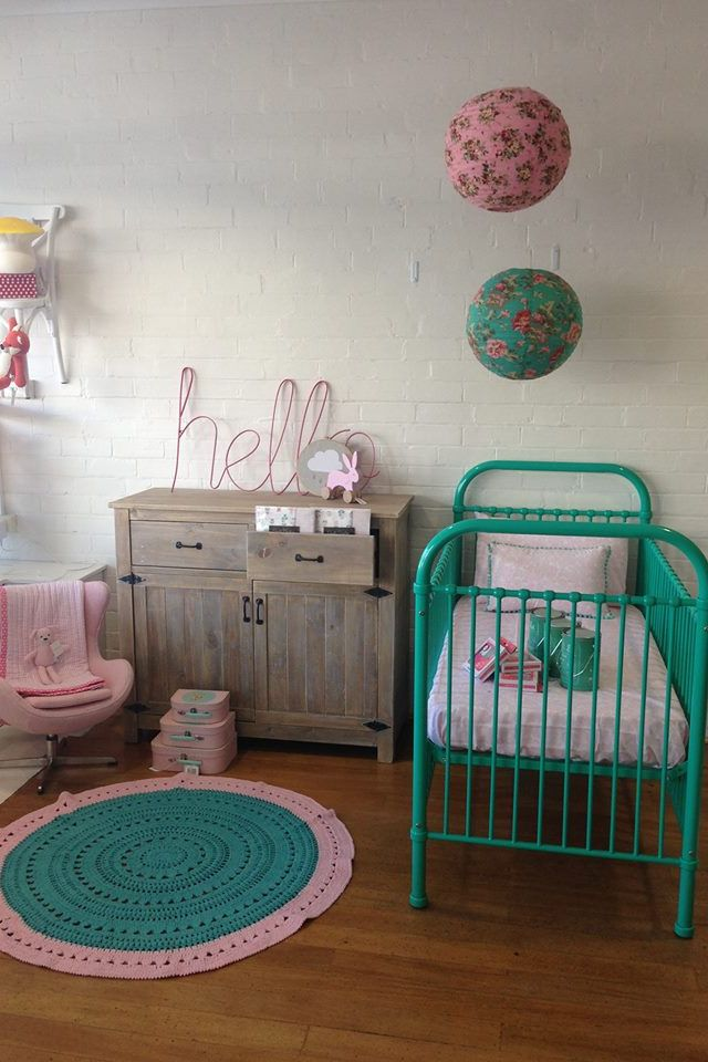 Pink/green nursery. I have this green lantern at home! Adore the rug!