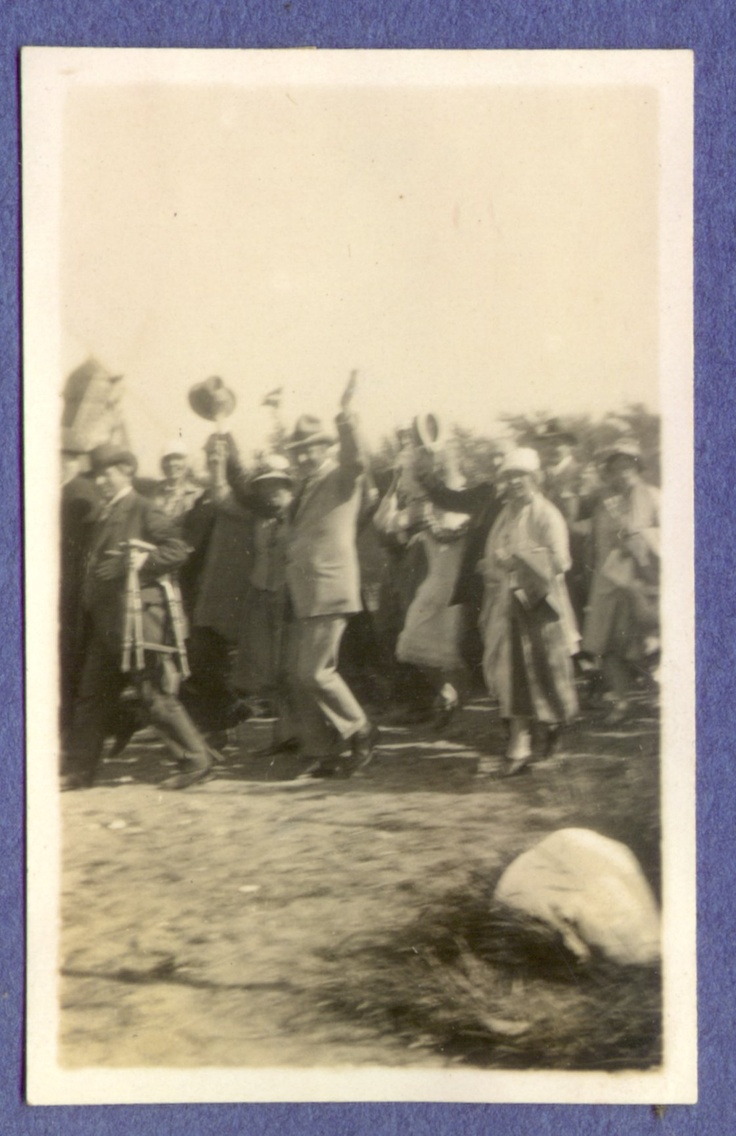 """Bucholtz saluting while walking to """"The Jenle Festival"""" 1929 - at his side his wife Olga. Just in front of him Jeppe Aakjær carrying a portable chair and looking very pleased towards the camera."""