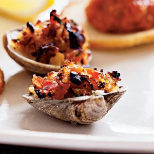 Clams Casino with Pancetta Cooking spray $ 3/4 cup finely diced pancetta 2 tablespoons dry white wine 1/3 cup finely diced red bell pepper $ 3 tablespoons minced shallots 1 garlic clove, minced 1 (1 1/2-ounce) slice day-old country white bread $ 1 1/2 tablespoons grated fresh Parmigiano-Reggiano cheese 2 teaspoons finely chopped fresh parsley 1/4 teaspoon black pepper 36 littleneck clams, cleaned $ Lemon wedges (optional)