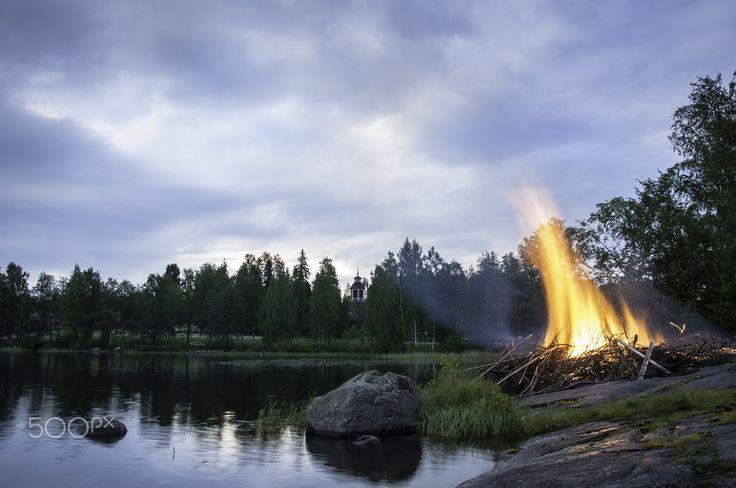Midsummer bonfire in Finland - Traditional midsummer (summer solstice) bonfire in Savonlinna, Finland.