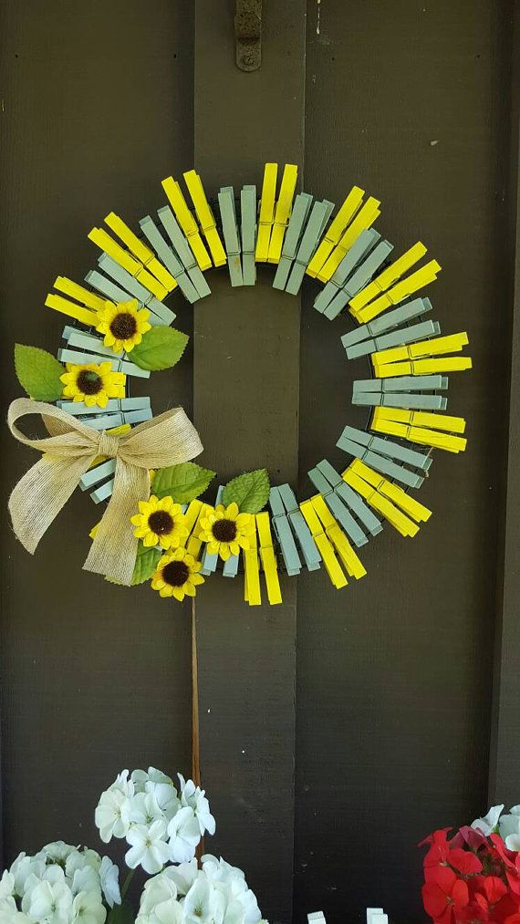 This wreath is made with painted clothes pins, mustard yellow and grey, little garnishes of sunflowers, perfect for your door!  Size - 14 radius Shipping in 3/5 business days.