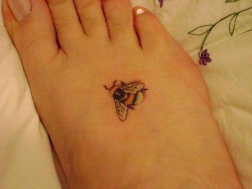 Tiny Bee Tattoo. I don't see many that I like, but this one is cute.