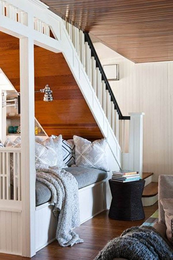 Under the steps: Turn basement into a cozy guest bedroom