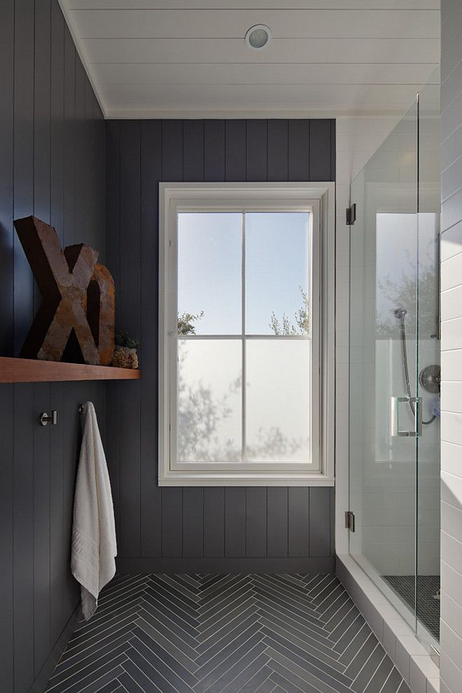 "Bathroom features vertical shiplap and limestone herringbone tile. The tiles are about 1 1/4″x 12″ each. Paint color is similar to ""Benjamin Moore Graphite""."
