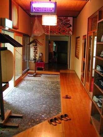 "Genkan. Japanese style ""mudroom"". Never wear outside shoes inside=clean floors!!!!"