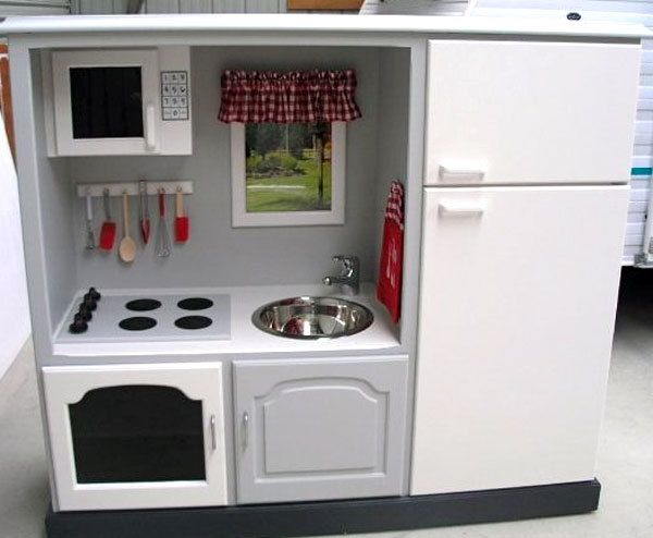 "convert old, junky entertainment center into awesome play kitchen - such a cute idea! I would love to make this for future children, whether they want to ""fix"" the sink or ""cook"" dinner :)"