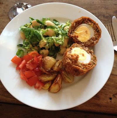 Scotch eggs with white bean and courgette salad