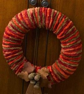 Welcome autumn's arrival warmly with this colorful DIY yarn wreath in beautiful fall colors.
