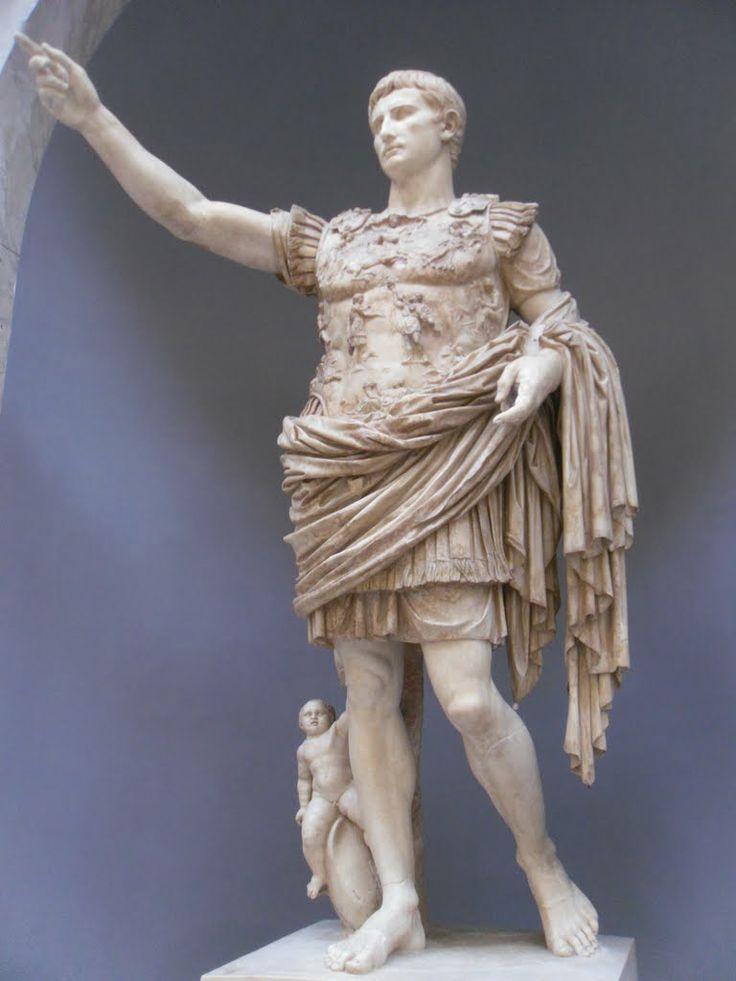 Augusto di Prima Porta - dopo il 20 a.C. - copia in marmo di un originale in bronzo - ritrovato a Roma - Roma, Musei Vaticani. Augusto ha il braccio destro sollevato nel gesto di chiedere la parola in assemblea. Il volto dell'imperatore, essendo un ritratto ufficiale,venne leggermente modificato e idealizzato, mantenendo però le sue fattezze originali. Ai suoi piedi c'è Eros,a cavallo di un delfino,che allude a Venere e alla gens Iulia. E' una statua che celebra la vittoria di Augusto sui…