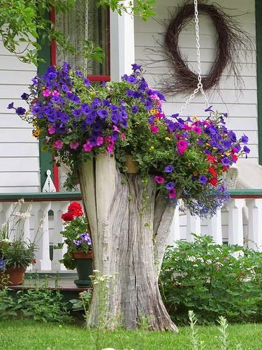 What a great use of that old tree stump. it is so colorful and beautiful