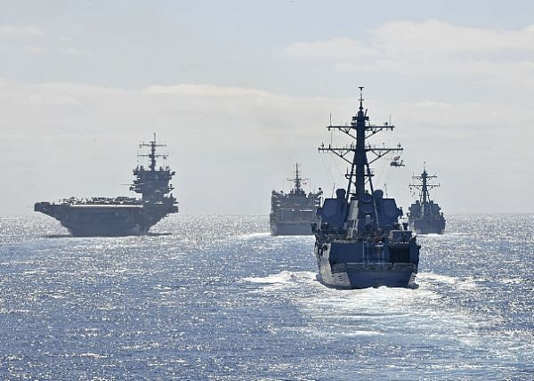 The aircraft carrier USS Enterprise (CVN 65), left, the ...