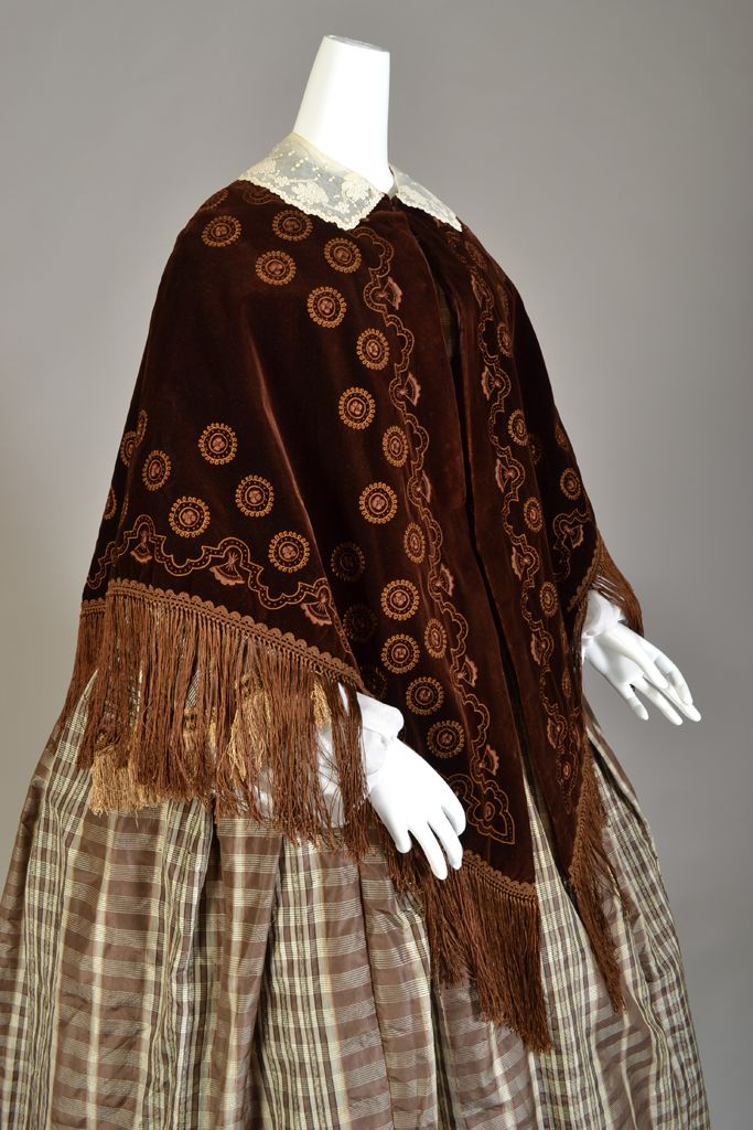 Brown silk velvet cape with ochre embroidery and fringe, American, ca. 1860. KSUM 2000.33.6