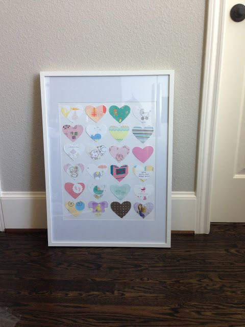 Turn baby shower cards into a piece of wall art!
