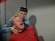 The Vulcan Nerve Pinch, an adequate way of stopping people who won't stop talking during concerts.