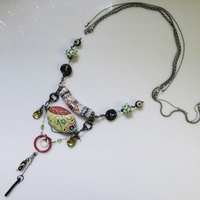 Handpainted beads in Jewelry.This necklace with pearls, lampworked glass beads, black coral and oxidised silver chains. www.carolinetrask.com
